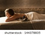 beautiful young woman in a spa... | Shutterstock . vector #144378835
