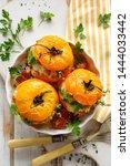 stuffed tomatoes  baked yellow...   Shutterstock . vector #1444033442
