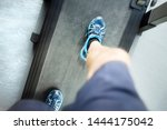 man looking down running in a... | Shutterstock . vector #1444175042