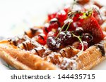 belgian waffles with fruit | Shutterstock . vector #144435715