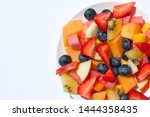 healthy fruit salad on a plate. | Shutterstock . vector #1444358435
