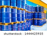 Small photo of Plastic containers palletized near the stock. Barrels for toxic substances. Chemical storage tanks. Barrels for shipment from stock. Transport of hazardous liquids. Warehouse work. Chemical industry.