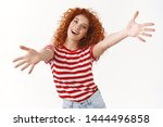 Stock photo come on give me energized lively smiling optimistic redhead curly woman tilt head joyfully stretch 1444496858