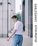 portrait of walking stylish man ...   Shutterstock . vector #1444537895