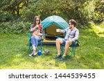 Stock photo people tourism and nature concept couple having fun on camping trip and play with cat 1444539455