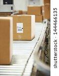 goods on conveyor belt in... | Shutterstock . vector #144466135