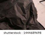 black creased crumpled paper... | Shutterstock . vector #1444689698