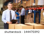 manager in warehouse checking... | Shutterstock . vector #144470392