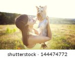Stock photo young woman with the dog outdoors 144474772