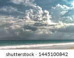 Small photo of Beautiful Landscape depicting Strange Weather Phenomenon due to Climate Change, comprising dramatic dark grey Nimbus clouds alongside natural beach, in Rainy season during a rough weather forecast.