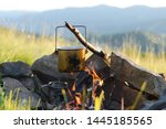 Cooking In A Pot Over Campfire...