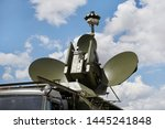 Military radar mobile complex against the sky with clouds. Radio monitoring and interception.
