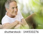 happy middle aged man reclining ... | Shutterstock . vector #144533276