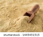 Small photo of Nutritional yeast background. Nutritional inactive yeast with small wooden scoop. Copy space. Nutritional yeast is vegetarian superfood with cheese flavor, for healthy diet