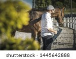 Caucasian Horse Owner in His 30s and the Equestrian Facility. Horse Passionate. - stock photo