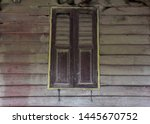 Old wooden windows are closed....