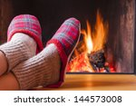 relaxing at the fireplace on...   Shutterstock . vector #144573008