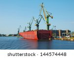 a large tanker ship is being... | Shutterstock . vector #144574448