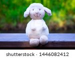 Cute White Toy Lamb Sits On A...