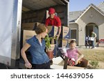 family and worker unloading...   Shutterstock . vector #144639056