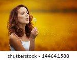 Happy Beautiful Woman Blowing...
