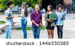Students and young adults talking and walking in city outdoor in summer