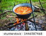 Cooking Outdoor On A Fire In A...