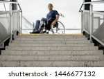 Wheelchair User At Stairs...