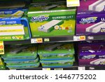 Small photo of Columbus,OH-USA June 27,2019: Swiffer wet jet pads displayed herein the laundry detergent and home cleaning products aisle in local supermarket.