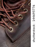 fragment of leather boot | Shutterstock . vector #144695776