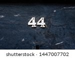 house number 44 with the forty... | Shutterstock . vector #1447007702