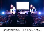 Blur image of sound engineer team working to prepare for music concert stage. - stock photo
