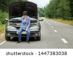 Worried Woman Sits On The...