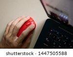 lefthander using computer mouse ... | Shutterstock . vector #1447505588