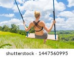 happy sporty female traveller... | Shutterstock . vector #1447560995