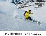 Skier Skidding In The Snow  Of...