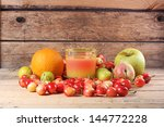 glass of juice with fruits | Shutterstock . vector #144772228