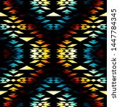 seamless pattern of a triangles.... | Shutterstock .eps vector #1447784345