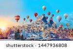 Small photo of Hot air balloon flying over spectacular Cappadocia - Girls watching hot air balloon at the hill of Cappadocia