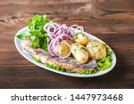 Stock photo russian cuisine in the form of potatoes with dill and herring in a white plate close up potatoes 1447973468