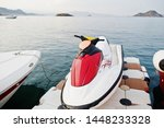 Red And Whithe Jet Ski On A...