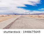 Cracked old highway in Bombay Beach abandned town, Palm Springs desert, California - stock photo