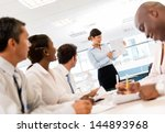 woman making a presentation in... | Shutterstock . vector #144893968