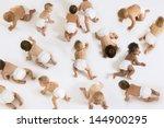 Stock photo group of multiethnic babies crawling isolated on white background 144900295