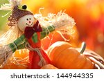 Scarecrow And Pumpkins On...