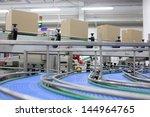 cardboard boxes on conveyor... | Shutterstock . vector #144964765