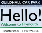 Small photo of Plymouth England July 2019. Large sign at entrance to car park with large black words HELLO! thereon. Other green and black writing. White background to sign