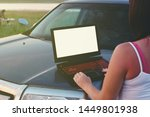 person uses laptop on the hood... | Shutterstock . vector #1449801938