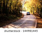 Abstract Blurred Car In Autumn...