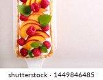 peach and raspberry cream tart... | Shutterstock . vector #1449846485